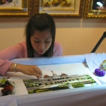 A Young Embroiderer Working on Architectural Subject
